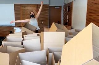 Person standing in a pile of boxes